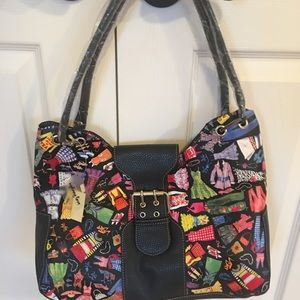 Purse with fun dresses printed on it